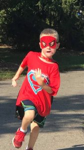 WSK Race Series, child dressed as super hero running the Kids race