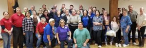 volunteer packing session -okemos group of service club members of the local Kiwanis club