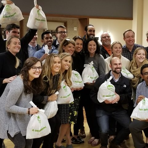 Picture of business associates volunteer at WSK Packing Session. Feeding Hungry Kids - A Good Investment!
