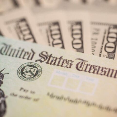 Stimulus check image with cash in the background